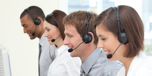 Serious coworkers in a call centerの写真素材 [FYI00482274]