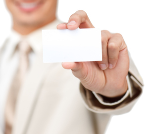 Close up of a Businessman holding a white cardの素材 [FYI00482280]