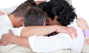 Confident business team hugging each other in a circleの素材 [FYI00482308]