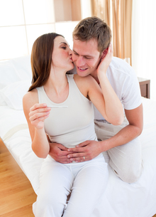 Affectionate couple finding out results of a pregnancy testの写真素材 [FYI00482410]
