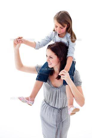 Merry mother giving her daughter piggyback rideの写真素材 [FYI00482446]