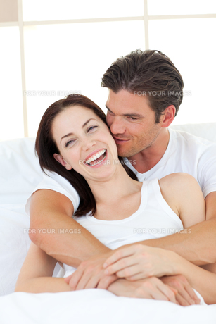 Caring man kissing his laughing wifeの写真素材 [FYI00482453]
