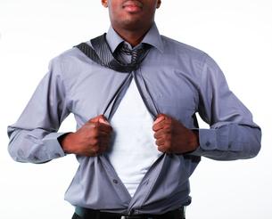 Businessman showing tshirt under his suitの写真素材 [FYI00482675]