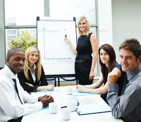 Attractive businesswoman giving a presentation smiling at the cameraの写真素材 [FYI00482715]