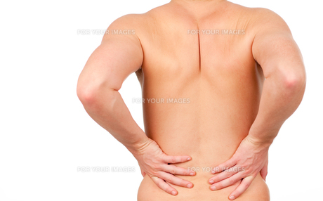 man showing that he has pain in his backの写真素材 [FYI00482718]