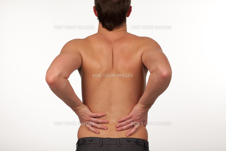 Man with backpain isolated agasint whiteの写真素材 [FYI00482721]