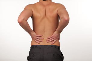 Man with backpain isolated agasint whiteの素材 [FYI00482722]