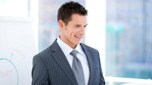 Portrait of a charismatic businessman at a presentationの素材 [FYI00482874]