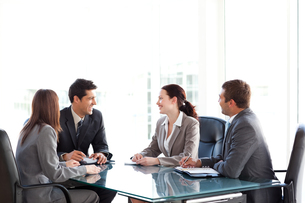 Happy Business team talking together during a meetingの写真素材 [FYI00483328]