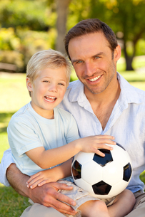 Father with his son after a football gameの写真素材 [FYI00483932]