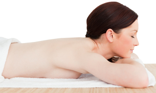 Young attractive redhaired woman posing while relaxing in a spa centreの写真素材 [FYI00484319]