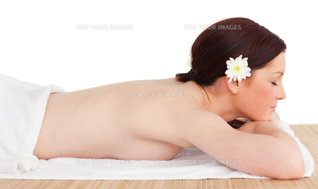 Portrait of a pretty serene woman posing while relaxing in a spa centreの写真素材 [FYI00484321]