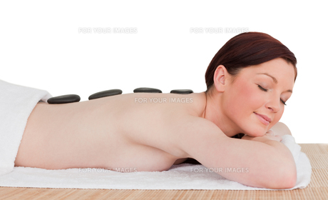 Portrait of a charming redhaired woman posing while relaxing in a spa centreの写真素材 [FYI00484325]