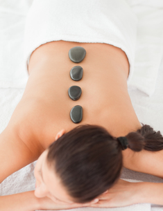 Black stones massage on a darkhaired womanの写真素材 [FYI00484348]
