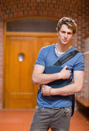 Portrait of a handsome student with a bookの写真素材 [FYI00484692]