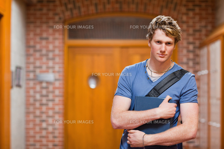 Handsome student with a bookの写真素材 [FYI00484693]