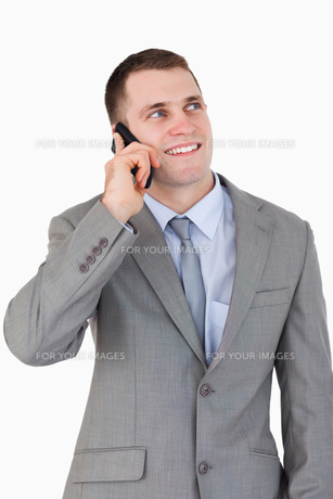 Close up of smiling businessman on the phoneの写真素材 [FYI00484747]