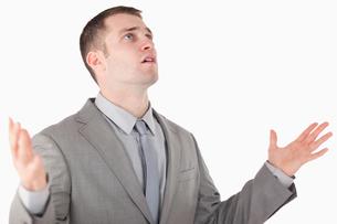 Worried entrepreneur prayingの素材 [FYI00484749]
