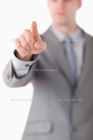 Portrait of a businessmans hand touching somethingの写真素材 [FYI00484751]