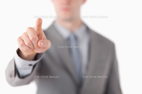 A businessmans hand touching somethingの写真素材 [FYI00484754]