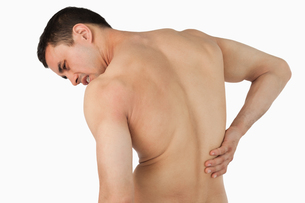 Back view of male suffering from back painの写真素材 [FYI00484772]