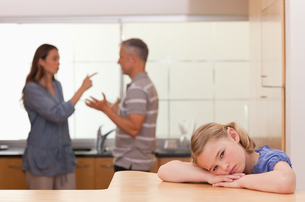 Sad little girl listening her parents having an argumentの写真素材 [FYI00484890]
