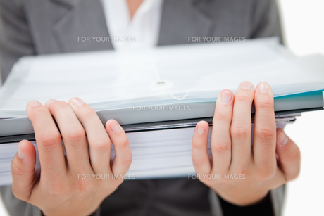 Pile of paperwork being held by female handsの写真素材 [FYI00484929]