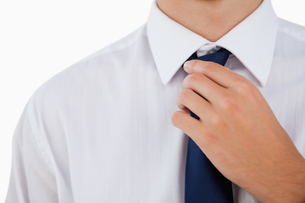Close up of a man doing his tieの写真素材 [FYI00485006]