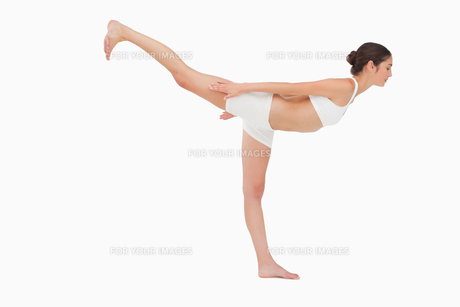 Woman in yoga positionの写真素材 [FYI00485032]