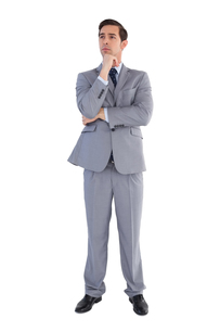 Serious businessman standing and thinkingの写真素材 [FYI00485347]