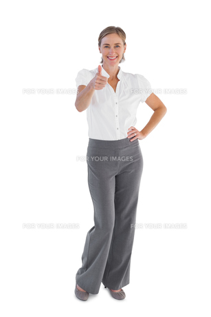 Smiling businesswoman showing her thumb upの写真素材 [FYI00485353]