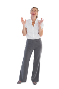 Cheerful businesswoman standing with raised handsの写真素材 [FYI00485355]