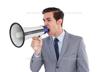 Businessman yelling into a megaphoneの写真素材 [FYI00485357]