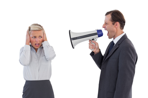 Businessman shouting at colleague with his bullhornの写真素材 [FYI00485362]