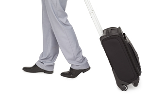 Businessman legs walking with a suitcaseの写真素材 [FYI00485363]