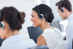 Three call centre employees workingの写真素材 [FYI00485379]