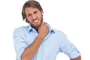 Tanned man having a neck acheの写真素材 [FYI00485418]
