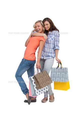 Two women with shopping bagsの素材 [FYI00485423]