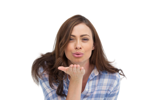 Cute woman blowing a kiss to the cameraの写真素材 [FYI00485429]