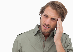 Man with headache looking away and wincingの写真素材 [FYI00485447]