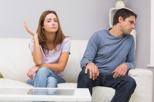 Unhappy couple not talking after argument at homeの写真素材 [FYI00485655]