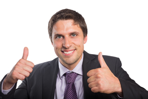 Closeup of a businessman gesturing thumbs upの写真素材 [FYI00485732]