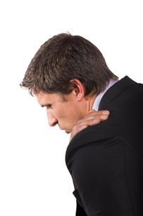 Businessman suffering from shoulder painの写真素材 [FYI00485733]