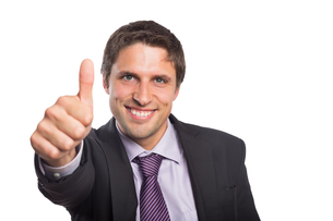 Closeup of a businessman gesturing thumbs upの写真素材 [FYI00485735]