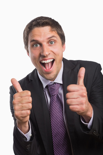 Cheerful businessman gesturing thumbs upの素材 [FYI00485742]