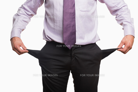 Mid section of a businessman with pockets pulled outの写真素材 [FYI00485750]
