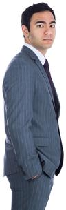 Unsmiling businessman standingの写真素材 [FYI00485770]