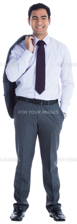 Smiling businessman standingの写真素材 [FYI00485781]