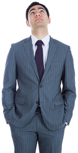 Unsmiling businessman standingの写真素材 [FYI00485782]