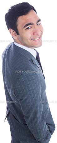 Unsmiling businessman standingの写真素材 [FYI00485786]